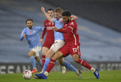 Liverpool's Joe Gomez, right, challenges Manchester City's Kevin De Bruyne during the English Premier League soccer match between Manchester City and Liverpool at the Etihad stadium in Manchester, England, Sunday, Nov. 8, 2020. (Shaun Botterill/Pool via AP)  TH128