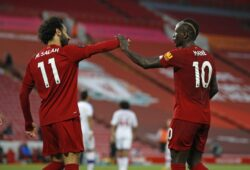 Liverpool's Sadio Mane, right, celebrates scoring his side's fourth goal with Mo Salah during the English Premier League soccer match between Liverpool and Crystal Palace at Anfield Stadium in Liverpool, England, Wednesday, June 24, 2020. (Phil Noble/Pool via AP)  TH159