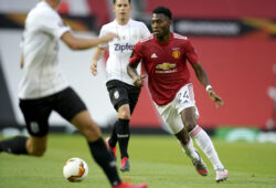 Manchester United's Timothy Fosu-Mensah, right, looks for support during the Europa League round of 16 second leg soccer match between Manchester United and LASK at Old Trafford in Manchester, England, Wednesday, Aug. 5, 2020. (AP Photo/Dave Thompson)  XMB109