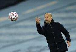 Manchester City's head coach Pep Guardiola throws the ball during the Champions League group C soccer match between Manchester City and Olympiacos at the Etihad stadium in Manchester, England, Tuesday, Nov. 3, 2020. (AP Photo/Dave Thompson)  XDMV123
