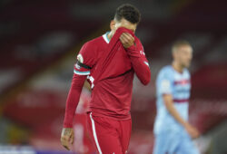 Liverpool's Roberto Firmino wipes his face during the English Premier League soccer match between Liverpool and West Ham United at Anfield stadium in Liverpool, England, Saturday, Oct. 31, 2020. (AP Photo/Jon Super, Pool)  LKW152