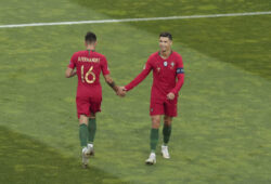 Portugal's Cristiano Ronaldo, right, shakes hands with Portugal's Bruno Fernandes during the UEFA Nations League final soccer match between Portugal and Netherlands at the Dragao stadium in Porto, Portugal, Sunday, June 9, 2019. (AP Photo/Luis Vieira)