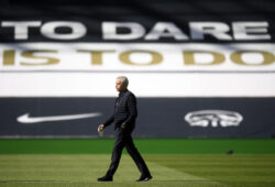 Tottenham's manager Jose Mourinho walks on the pitch before the English Premier League soccer match between Tottenham Hotspur and Arsenal at the Tottenham Hotspur Stadium in London, England, Sunday, July 12, 2020. (Michael Regan/Pool via AP)  XAF114