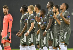 Manchester United players line up prior to the start of an Europa League semifinal match between Sevilla and Manchester United, in Cologne, Germany, Sunday, Aug. 16, 2020. (AP Photo/Martin Meissner, Pool)  AJM133