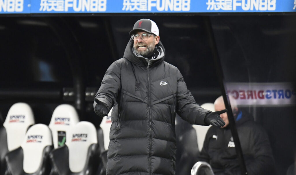 Liverpool's manager Jurgen Klopp gestures from the sidelines during the English Premier League soccer match between Newcastle United and Liverpool at St James' Park stadium in Newcastle, England, Wednesday, Dec. 30, 2020. (Peter Powell/ Pool via AP)  XAG136