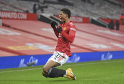 Manchester United's Marcus Rashford celebrates after scoring the opening goal during the English Premier League soccer match between Manchester Utd and Wolverhampton Wanderers at Old Trafford stadium in Manchester, England, Tuesday,Dec. 29, 2020. (Michael Regan, Pool via AP)  TH143