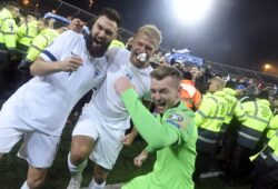 Finnish captain Tim Sparv, left, celebrates with Paulus Arajuuri, center, and goalkeeper Lukas Hradecky after their victory in the Euro 2020 Group J qualifying soccer match between Finland and Liechtenstein in Helsinki, Finland, on Friday, Nov. 15, 2019. Finland won 3-0 and have qualified for a major soccer tournament for the first time in their history. (Markku Ulander/Lehtikuva via AP)  LLTT820