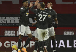 Manchester United's Marcus Rashford, left, celebrates with teammates after scoring during the English Premier League soccer match between Sheffield United and Manchester United at the Bramall Lane stadium in Sheffield, England, Thursday, Dec. 17, 2020. Manchester United won the match 3-2. (AP Photo/Rui Vieira, Pool)  XLP252