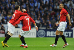 Manchester United's Cristiano Ronaldo, center,  celebrates with Wayne Rooney, left, and Rio Ferdinand after scoring against FC Porto in a Champions League quarterfinal second leg soccer match Wednesday, April 15, 2009 at the Dragao stadium in Porto, Portugal. (AP Photo/Paulo Duarte)