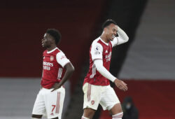 Arsenal's Gabriel, right, leaves the pitch after being sent off for a foul on Southampton's Theo Walcott, bottom, during an English Premier League soccer match between Arsenal and Southampton at the Emirates stadium in London, England, Wednesday, Dec. 16, 2020. (Peter Cziborra/Pool via AP)  XVG164