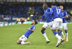 Everton's Dominic Calvert-Lewin, left, celebrates after Arsenal's Rob Holding scored an own goal during the English Premier League soccer match between Everton and Arsenal at Goodison Park in Liverpool, England, Saturday, Dec. 19, 2020. (Peter Powell/Pool via AP)  XSG118