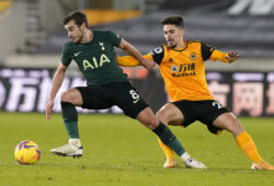 December 27, 2020, Wolverhampton, United Kingdom: Harry Winks of Tottenham (L) holds off Vitinha of Wolverhampton Wanderers during the Premier League match at Molineux, Wolverhampton. Picture date: 27th December 2020. Picture credit should read: Andrew Yates/Sportimage.